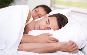 man-and-woman-sleeping-white-bed